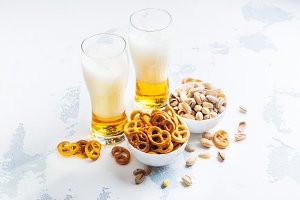 Beer and snacks on white background
