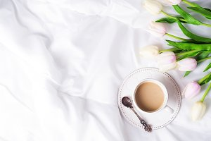 Pink tulips and coffee cup