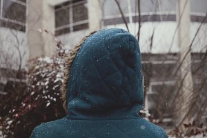 Girl in Hooded Jacket in Snow