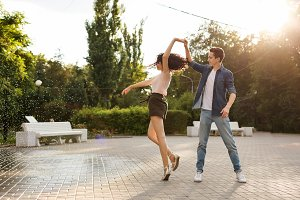 Teens dancing in the park