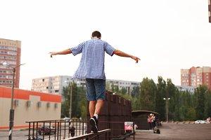 Man is walking on the railing