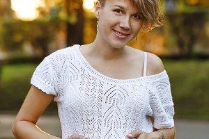 Pregnant girl. Portrait outdoors