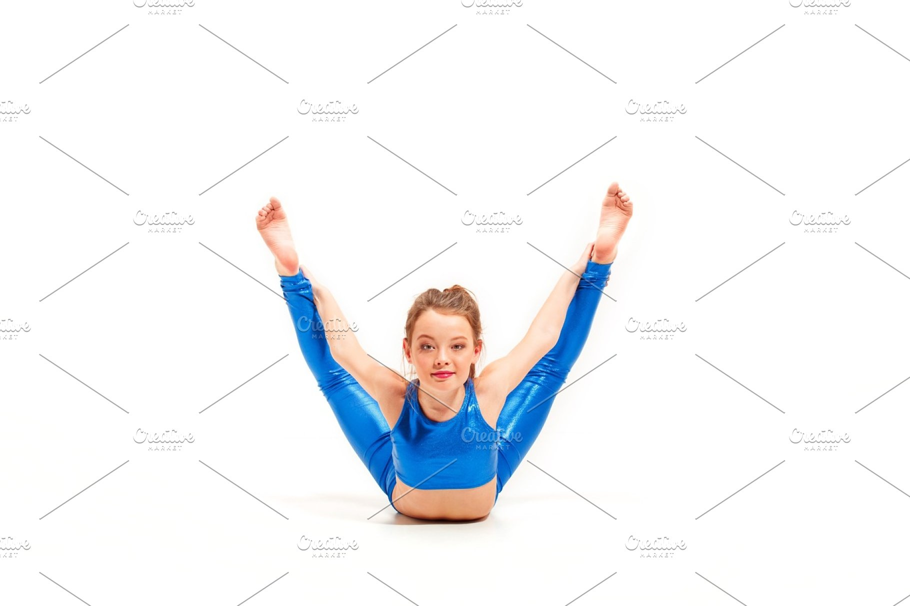 9dcf0114a The teenager girl doing gymnastics exercises isolated on white ...