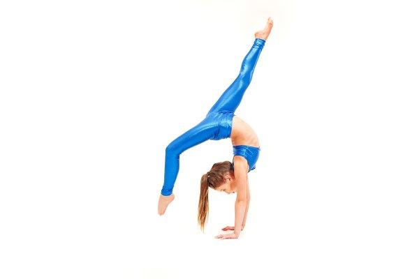The teenager girl doing gymnastics…