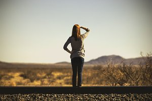 Girl Standing on Railroad Looking
