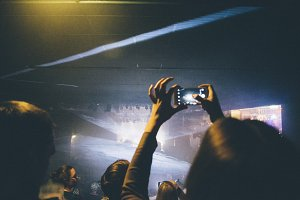 People shoot concert on phone