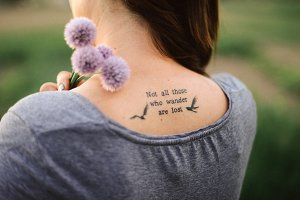 Quote tattoo on the back