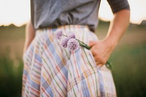 Woman holding chives flowers