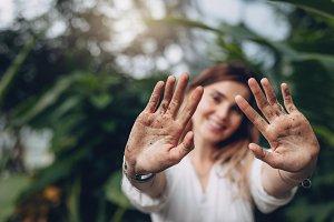 Gardener showing her dirty palms
