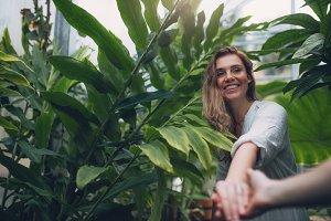 Couple in tropical botanical garden