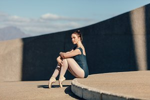 Female ballet dancer sitting