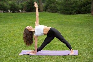 Pretty woman doing yoga exercises