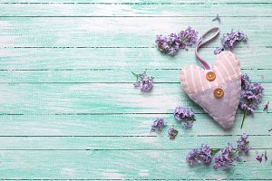 Decorative heart and lilac flowers