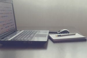 Laptop, notebook and pen
