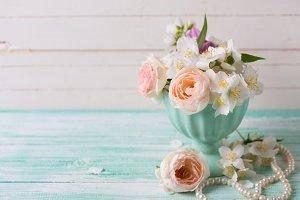 Pastel roses and jasmine flowers