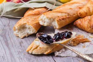 French baguette with butter and jam for breakfast