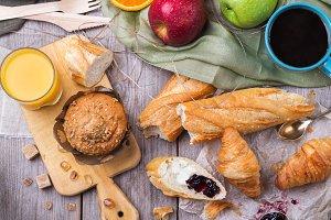 Breakfast with orange juice coffee bread croissant butter jam