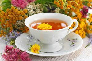 Cup of herbal tea and flowers