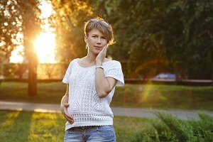 Pregnant girl. Portrait at sunset