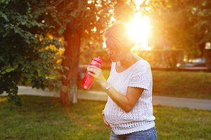 Pregnant girl drinking water