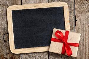 Blank blackboard and gift box