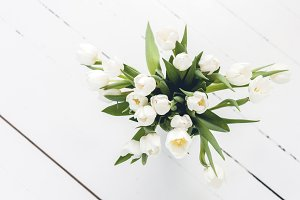 White Tulips on Wooden Floor