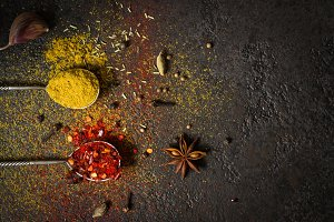 Spices food background. selection variety dry Whole and ground spices on a black background