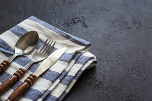 Food cooking background. Careless simple table setting. Set of cutlery with wooden handles.