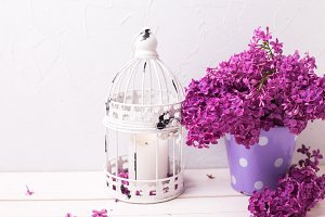 Lilac flowers and candle
