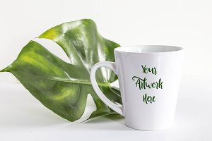 Latte Mug mockup with monstera leaf