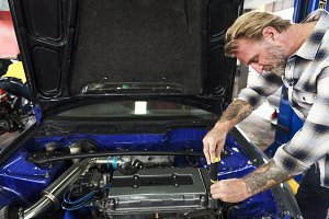 Mechanic working with engines