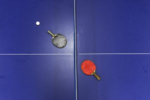 Table tennis racket & ball on table
