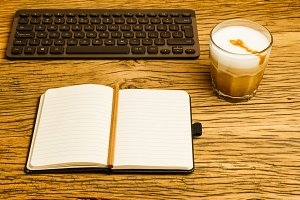 Concept empty notebook pencil keyboard start day