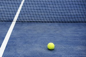 Closeup of tennis ball in the court