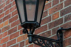 Antique lantern on brick wall