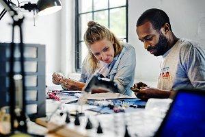 Technicians working on electronics