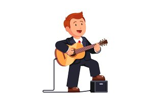 Business man in a suit playing guitar and singing