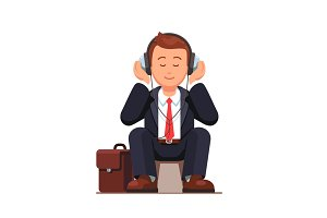 Business man listening to music and sitting
