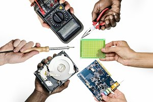 hands holding electronic parts