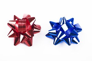 Bow with star shape of red and blue  color decoration paper on white background