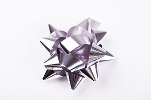 Bow with star shape of grey  color decoration paper on white background