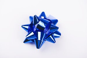 Bow with star shape of blue  color decoration paper on white background