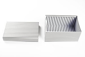 Top view of white box with black stripes open with lid on white background. Isolated.