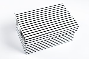 Top view of white box with black stripes on white background. Isolated.