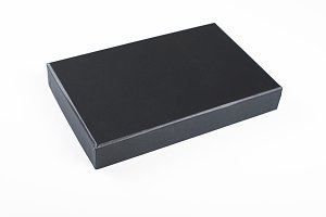 Top view of Lid of a box of black color on white background. Isolated.