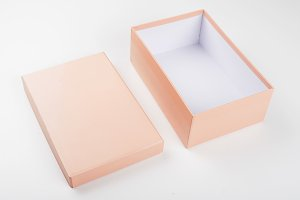 Top view of open orange box with lid on white background. Isolated.