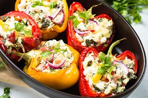Stuffed paprika peppers with cheese and herbs.