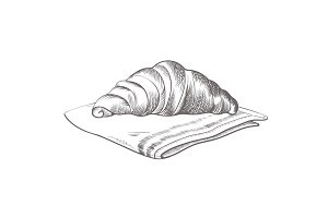 Hand drawn croissant lying on cloth isolated illustration