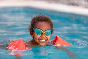Happy african child in the pool