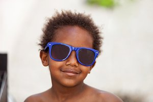 Funny african child with sunglasses
